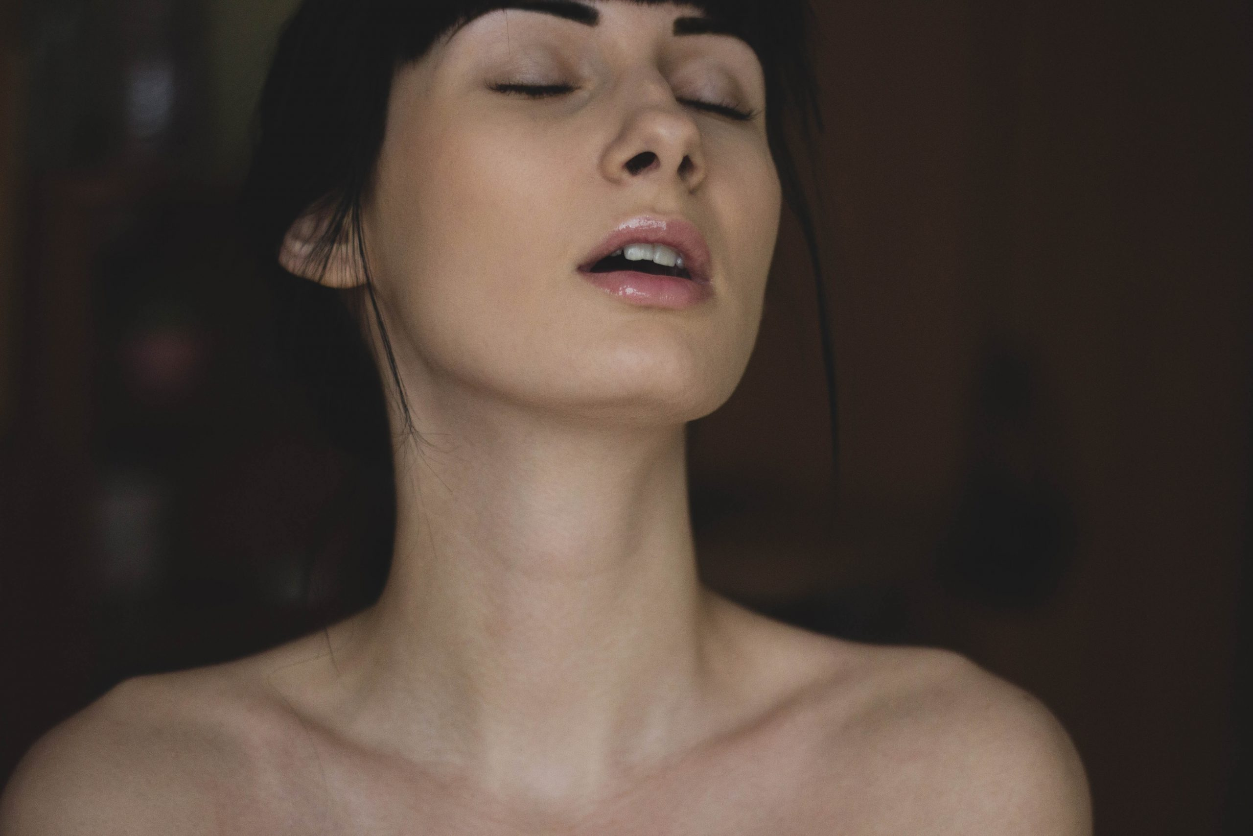 Topless woman closing her eyes